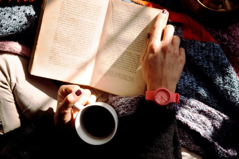 a book and a cup of coffee